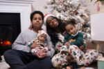 Black mom and kids wearing matching pjs